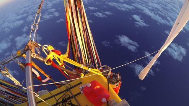 On a World–Record Balloon Journey Across the Pacific with Iridium