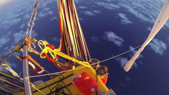 On a World–Record Balloon Journey Across the Pacific with Iridium