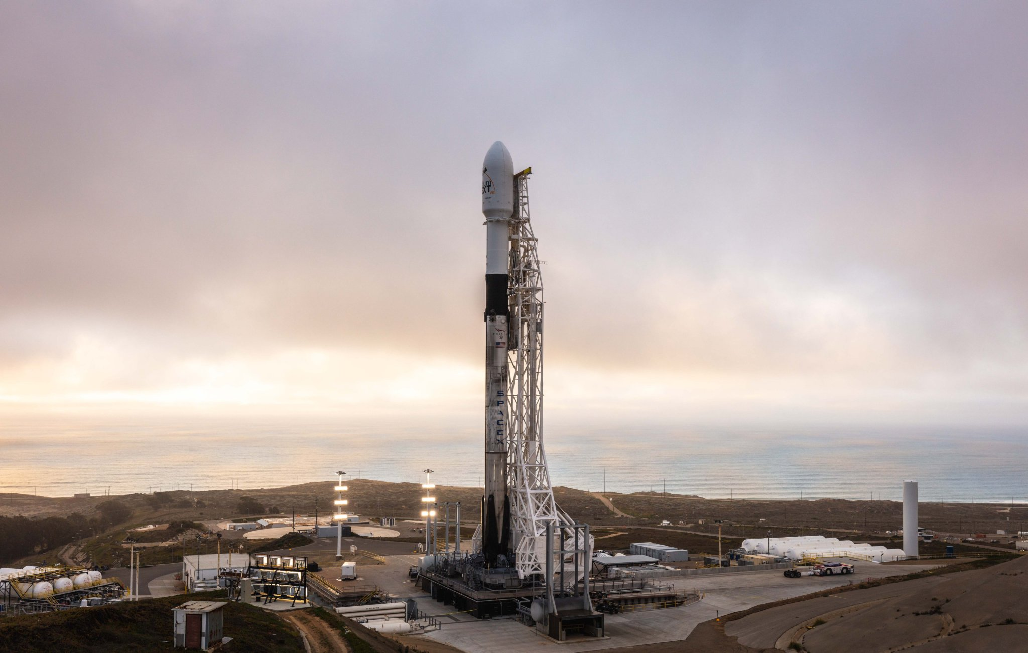 Falcon 9 rocket vertical on SpaceX launch pad 8th Iridium launch.