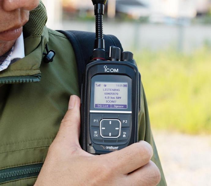 Icom IC-SAT100 ptt handset in use