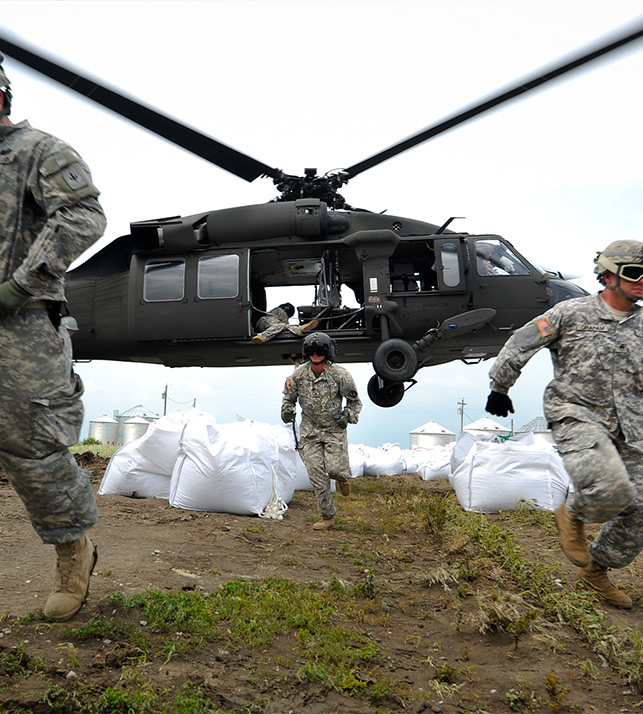 U.S. army soldiers deplaning from a helicopter