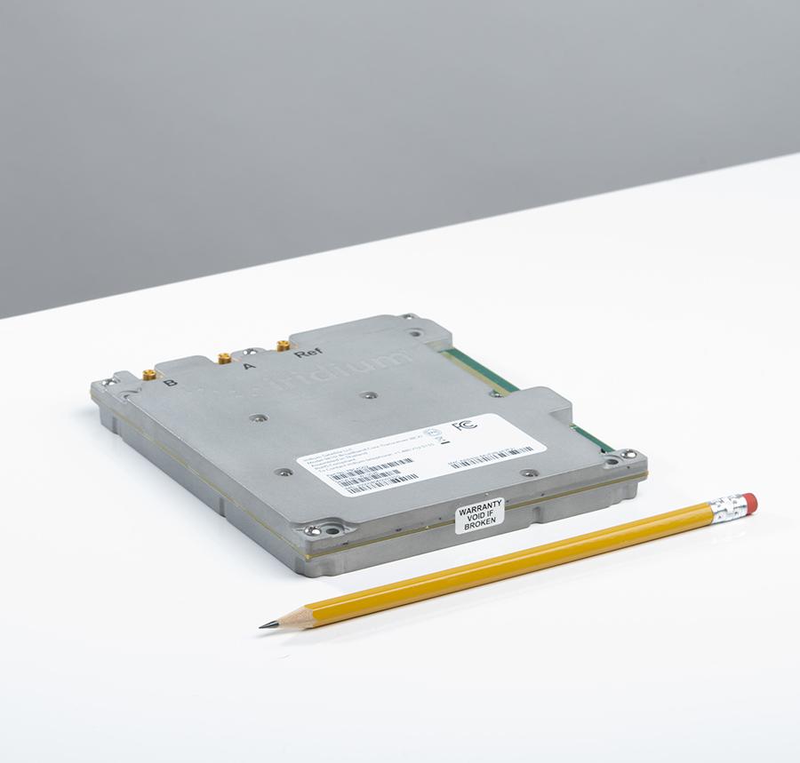 Iridium Certus 9810 module to scale next to pencil