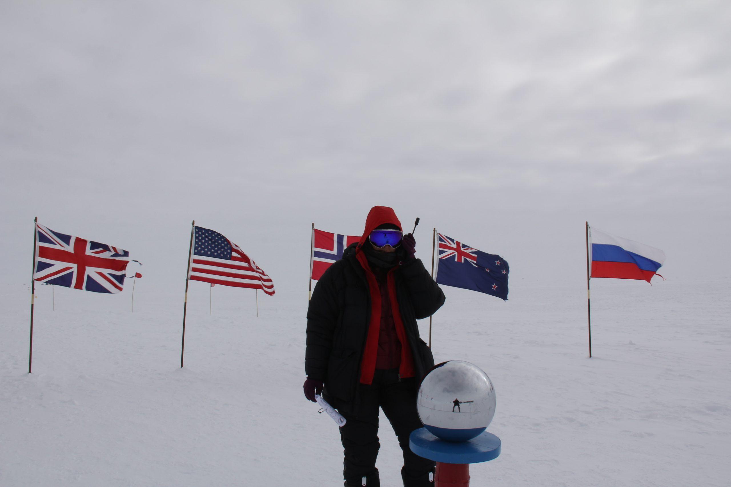 A polar explorer using the Iridium 9555 satellite phone at the South Pole.